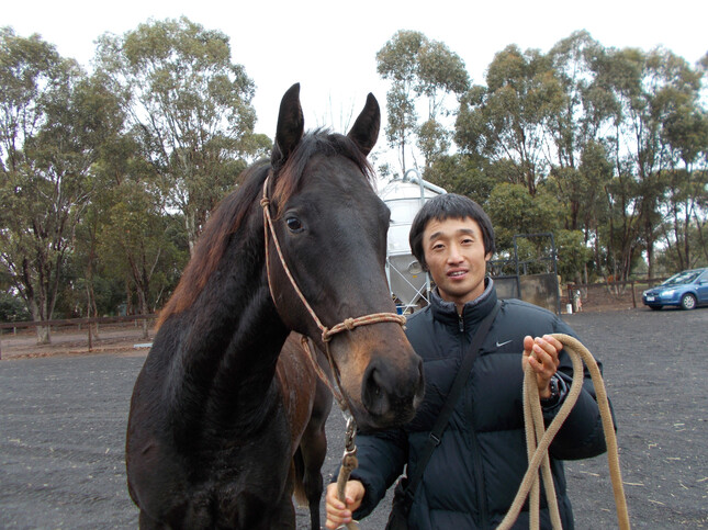 Former Cm employee Kenji Konishi pictured with Beyond The Dream as a yearling.